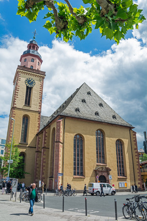 st german: FRANKFURT AM MAIN, GERMANY - MAY 19, 2016: Catherine Church. The largest Lutheran church in Frankfurt. Surrounding is shopping district streets, including an underground pedestrian area. Editorial