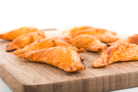 Traditional Cornish Pasties on Wooden Board in Kitchen