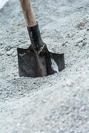 bayonet: rough bayonet shovel stuck in a pile of gravel