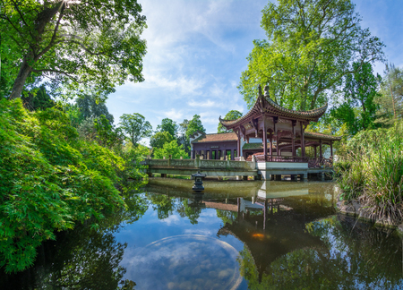 FRANKFURT AM MAIN, GERMANY - MAY 18, 2016: Chinese park in Frankfurt am Main. A quiet, beautiful place to relax. Popular with locals and tourists. It recreates the atmosphere of eastern culture in the heart of Europe.