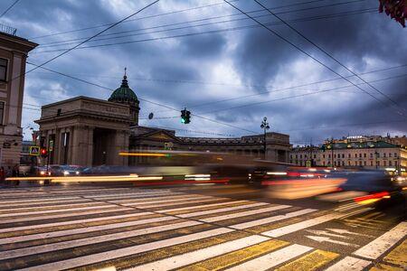 sobor: ST. PETERSBURG, RUSSIA - JULY 13, 2016: Kazanskiy Cathedral in Saint Petersburg in Russia, blurred traffic under stormy skies Editorial
