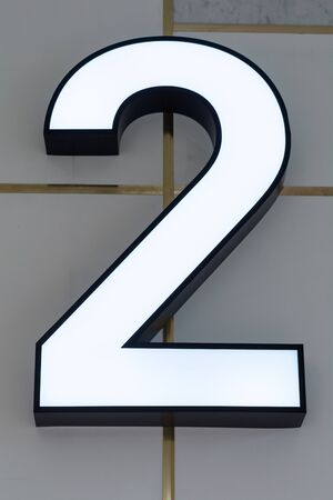 second floor: Number 2 Neon sign on the wall Stock Photo