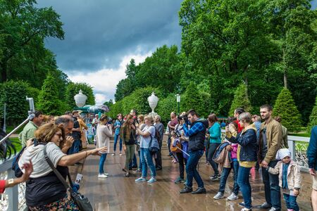 rundale: PETERHOF, RUSSIA - JULY 13, 2016: Tourists make photo in Peterhof, known for its palaces and fountains Editorial