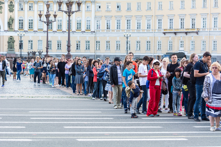 ST. PETERSBURG, RUSSIA - JULY 12, 2016: Tourists stand in queue long hours in the State Hermitage Museum, St. Petersburg, Russia