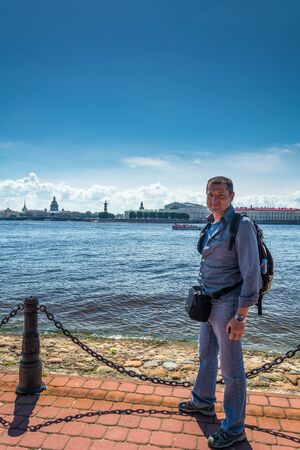 neva: Tourist admiring views of Neva embankment, St. Petersburg, Russia Stock Photo