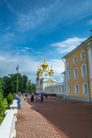 PETERHOF, RUSSIA - JULY 13, 2016: Peters Palace at Peterhof, St Petersburg, Russia. Hundreds of fountains and golden statues surround Peters Palace- Russias answer to Versailles. Editorial