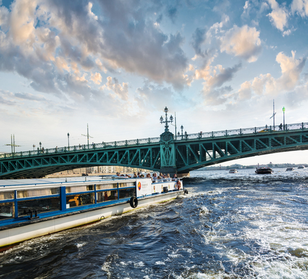 ST. PETERSBURG, RUSSIA - JULY 14, 2016: Boat floats on the background of the drawbridge in St. Petersburg. Editorial