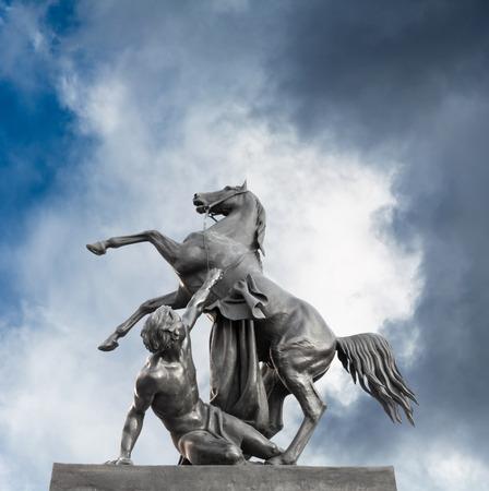 subjugation: Horse holding man sculpture of Anichkov Bridge in Saint Petersburg