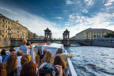 leningrad: ST. PETERSBURG, RUSSIA - JULY 14, 2016: Many tourists enjoy boat trips in St. Petersburg, Russia