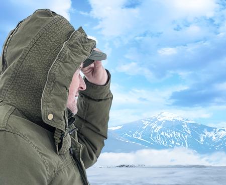 Adventurous senior man with backpack photo