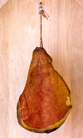 Serrano ham shown hanging on