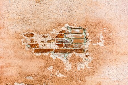 Empty Old Brick Wall and remnants of plaster Texture. Painted Distressed Wall Surface.
