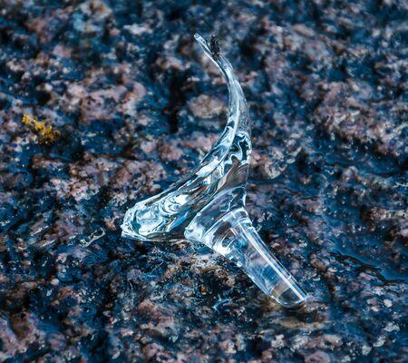 Broken wedding glass on granite pavement