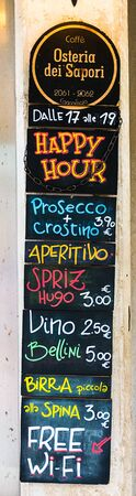 VENICE, ITALY - MAY 15, 2019: Promotional menu of the restaurant in Venice, prices and meals