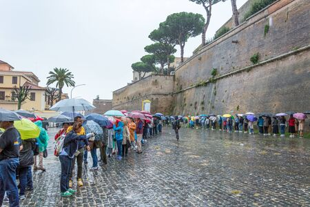 Rome, Italy - Oct 06, 2018: The queue to visit the Vatican on a rainy day