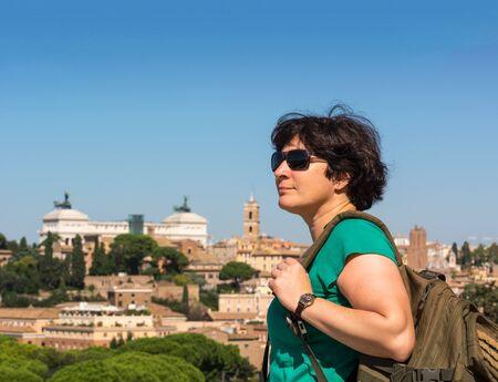 Tourist admired of View on Rome from Orange Garden, Giardino degli Aranci on Aventine hill