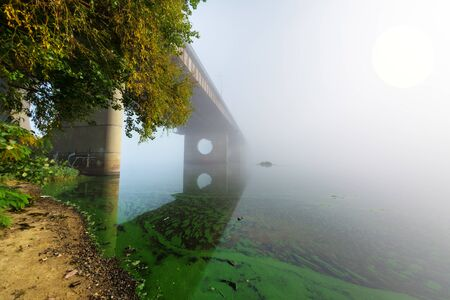 bridge over foggy river. Coastal landscape . Kiev. Ukraine. Stok Fotoğraf