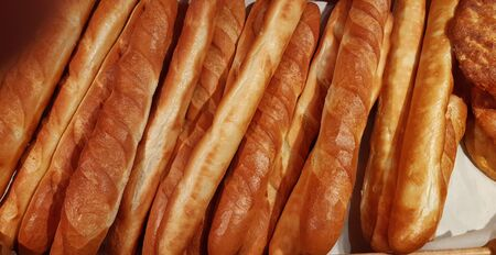 fresh rosy appetizing baguettes close up