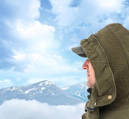 Adventurous senior man with backpack