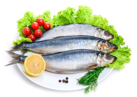 salted herring with red tomato and parsley Banque d'images