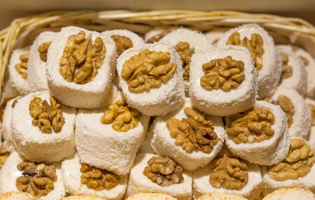 Eastern sweets in a wide range, baklava, Turkish delight with almond, cashew and pistachio nuts on plates