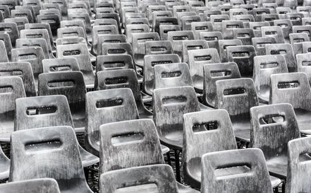 Rows of empty gray chairs in the rain, background. Banque d'images