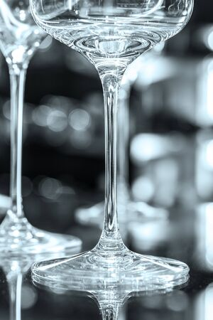 beautiful wine glasses in front of dark background