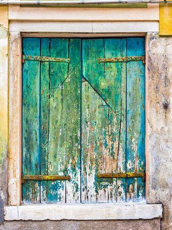 Venice, Italy - OCT 01, 2018: Ancient window shuttered, art object 版權商用圖片
