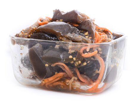 Roasted and marinated vegetables salad with carrot in a glass bowl