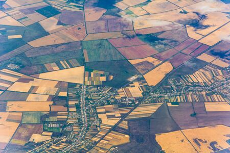High altitude view of European countryside, fields and townships