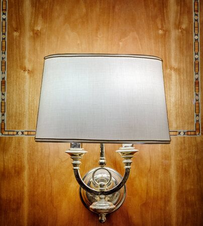 Lamp, sconce against a wooden wall