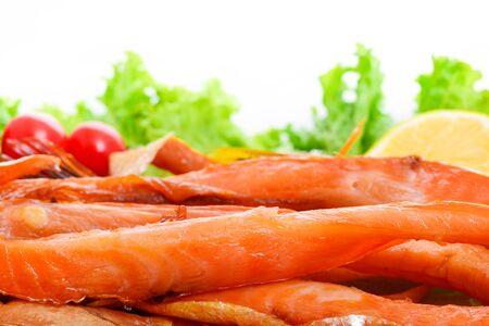 Appetizing smoked fish on a platter