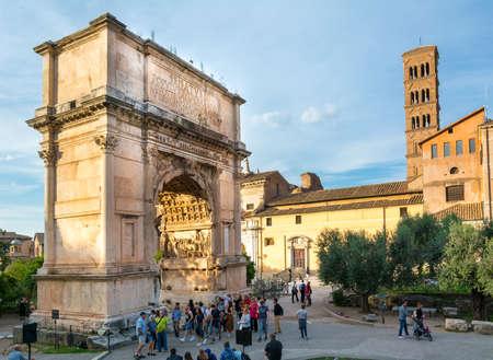 Rome, Italy - Oct 02, 2018: Tourists are walking around Arco di Tito