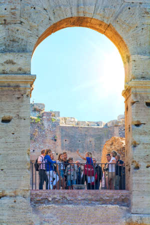 Rome, Italy - Oct 03, 2018: Tourists walk through the building of the Colosseum in Rome Éditoriale