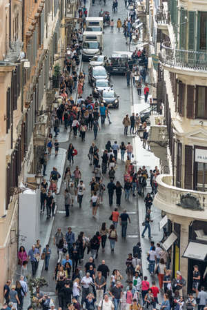 Rome, Italy - Oct 04, 2018: Tourists crowd and walk down the street Via dei Condotti, Rome
