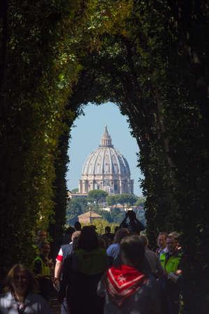 Rome, Italy - Oct 03, 2018: A particular view of the dome of St. Peter (Vatican City - Rome). At Piazza Cavalieri di Malta there is the Villa del Priorato of Malta Éditoriale