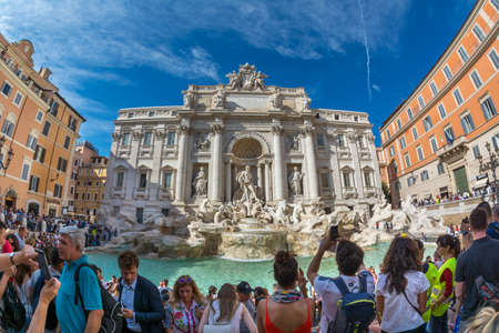 Rome, Italy - Oct 03, 2018: Bustle and fun around the Trevi Fountain in Rome