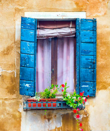 Venice, Italy - OCT 01, 2018: Ancient window with shutters, art object