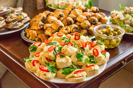canapes, sandwiches in assortment close up