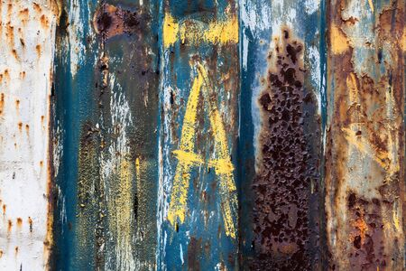 old metal: red rusted on the color metal wall with planks. background and Texture for your design. Stock Photo