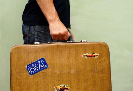 shabby old suitcase in a man Reklamní fotografie