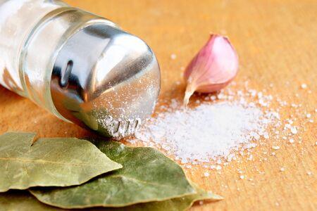 bay leaf: sprinkled salt, garlic clove and bay leaf