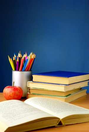 school subjects on the table, books, pencils Stock Photo