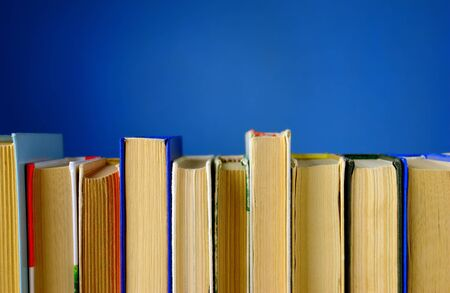 prose: a lot of books on a blue background