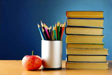 school book: school subjects on the table, books, pencils Stock Photo