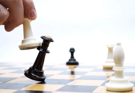 business competition: Shows chess on chess board Stock Photo