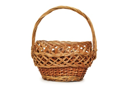 Basket made of twigs on a white background. Stock Photo