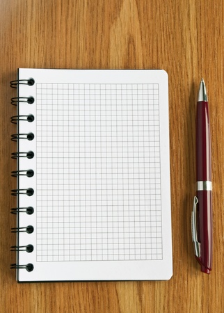 Notebook and pen on the table photo