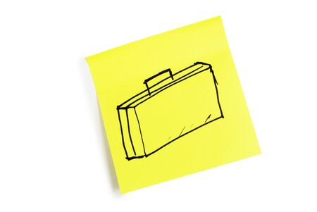 Reminder on a yellow sheet of paper Stock Photo - 10251501