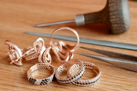 workbench: Jewelry and tools are on the table Stock Photo